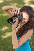 High angle view of brunette young woman taking a picture — Stock Photo