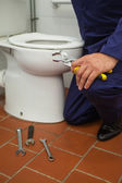 Close up of plumber holding pliers — Foto de Stock