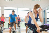 Tired people working out at spinning class — Stock Photo
