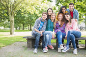 Portrait of young college students in park — Stock Photo