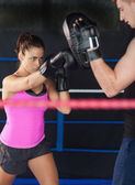 Determined female boxer practicing — Stock Photo
