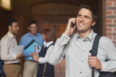 Happy mature student phoning with his smartphone — Stock Photo