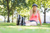 Casual happy blonde wearing roller blades — Stock Photo