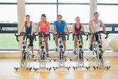 Five determined people working out at spinning class — Stock Photo
