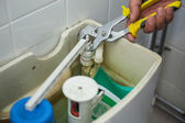 Close up of hand repairing toilet — Stock Photo