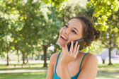 Happy young woman phoning with her smartphone — Stock Photo