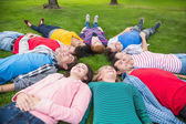 Group of friends lying down in park — Stock Photo