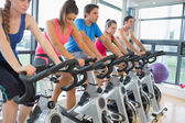 Determined people working out at spinning class — Photo