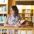 Female student with books in the library — Stock Photo