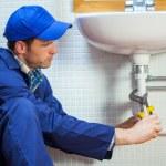 Attractive focused plumber repairing sink — Stock Photo #36182857