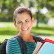 Casual cheerful student holding books — Stock Photo