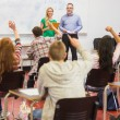 Students raising hands in the classroom — Stock Photo #36183617