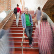 Stock Photo: Casual handsome student standing on stairs