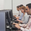 Mature students sitting in computer class — Stock Photo