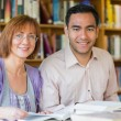 Stock Photo: Adult students studying together in the library