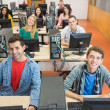 Smiling students in the college computer room — Stock Photo #36184897
