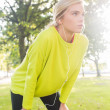 Active serious blonde catching her breath — Stock Photo