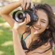 Stock Photo: High angle view of cheerful young womtaking picture