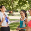 Three pretty sporty friends chatting — Stock Photo