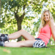 Casual smiling blonde wearing roller blades — Stock Photo #36185895