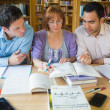 Adult students studying together in the library — Stock Photo #36185903