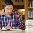 Mature student studying at desk in the library — Stock Photo #36186179