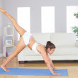 Slim woman stretching her body in yoga pose — Stock Photo #36186193