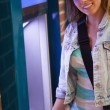 Stock Photo: Pretty cheerful student withdrawing cash smiling at camera