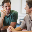Two friendly male mature students chatting — Stock Photo