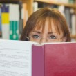 Mature female student reading a book — Stock Photo #36187383