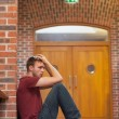 Unhappy handsome student having headache — Stockfoto #36187555