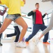 Stock Photo: Fitness class and instructor doing pilates exercise