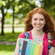Stock Photo: Gorgeous smiling student holding notebooks