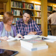 Mature students in the library — Stock Photo