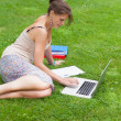 Female student with laptop and books at the park — Stock Photo
