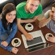 Students using laptop while having coffee at coffee shop — Stock Photo #36189155