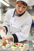 Pretty concentrated head chef preparing dessert — Stock Photo