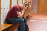Upset handsome student having a headache — Stock Photo