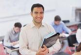 Portrait of handsome teacher posing in his classroom — Stock fotografie