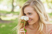 Content young woman smelling a white flower — Stock Photo