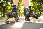 Close up of woman wearing inline skates — Stock Photo