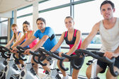People working out at spinning class — Stok fotoğraf