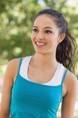 Front view of joyful young woman wearing sportswear — Stock Photo