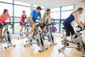 Determined people working out at spinning class — Stock Photo