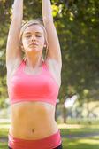 Active calm blonde doing yoga exercise — Stock Photo