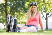 Casual cheerful blonde wearing roller blades — Stock Photo