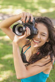 High angle view of cheerful young woman taking a picture — Stock Photo