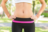 Mid section picture of toned belly from a woman — Stock Photo