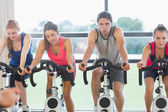 Determined people working out at spinning class — 图库照片