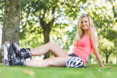 Casual smiling blonde wearing roller blades — Stock Photo